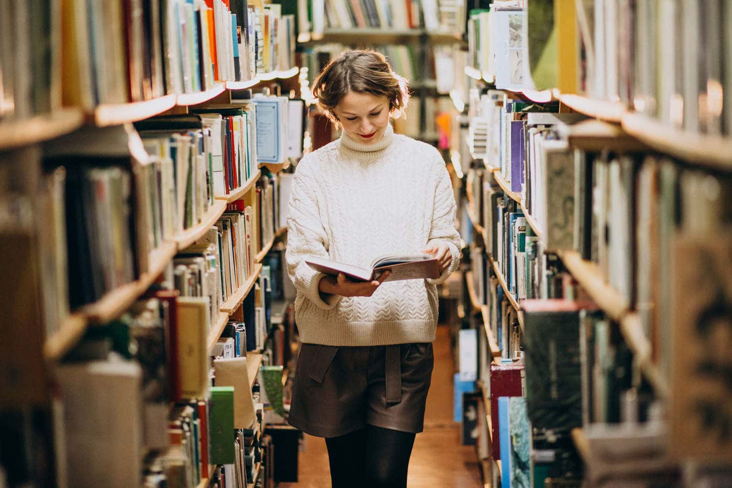 young-woman-studying-library